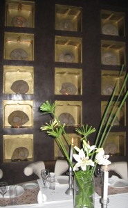 A Wall of Ammonites framed in brown tadelakt at Crystal, Marrakech